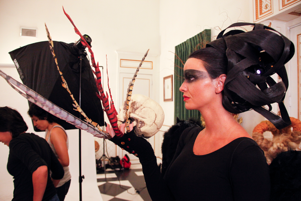 <p>Headliners Salon: The vulture-inspired model had it easiest on the nails. Short, jet black nails kept the focus on the model's hair, feathers, and skull.</p>
