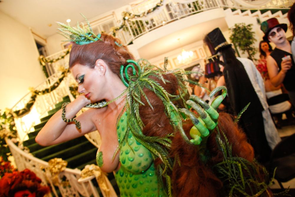 <p>Headliners Salon: Like the sun nails, Yavenue used three tips on each nail and used resins to adhere the wedding mesh to the tip. She then hand-painted the colors and added glitter to the back of the tips to resemble the belly of the snake.</p>