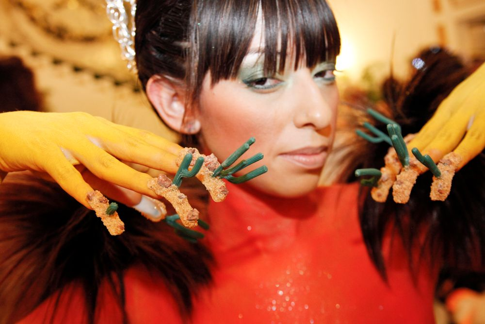 <p>Headliners Salon: Yavenue added sand in acrylic to create the landscape of the ground for her three-prong cacti.</p>