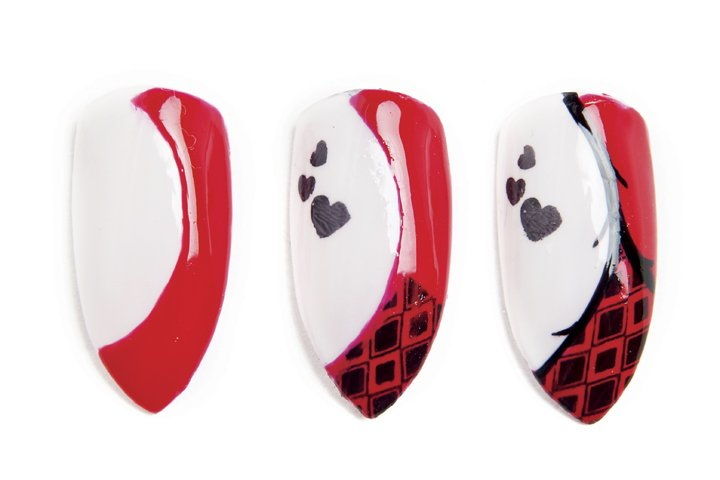"""<p>Harley Quinn nails by Tina Alberino. <a href=""""http://www.nailsmag.com/demosteps/95953/harley-quinn-inspired-villain-nails"""" target=""""_blank"""">Click here for the tutorial.</a></p>"""