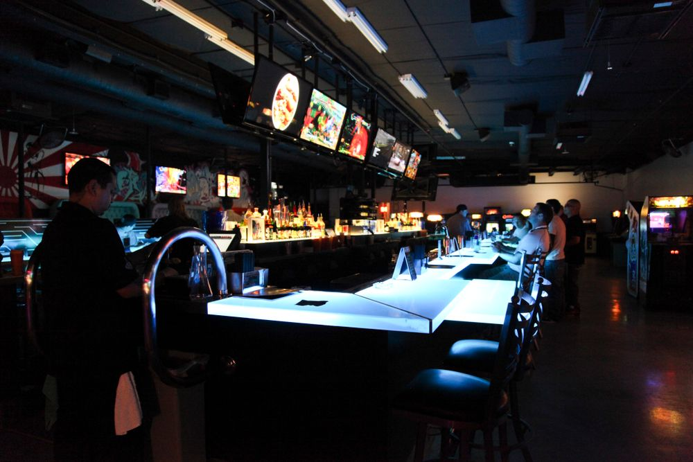 "<p><a href=""http://insertcoinslv.com"">Insert Coin(s) Video Game Arcade Bar</a> had a cool backlit bar counter and flat screens for video game play at the bar.</p>"