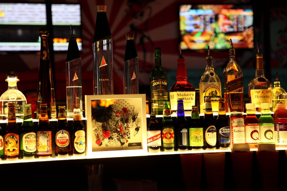 "<p>Framed nail art created by Beautiful Nails educators sits among the liquor at <a href=""http://insertcoinslv.com"">Insert Coin(s) Video Game Arcade Bar</a>.</p>"