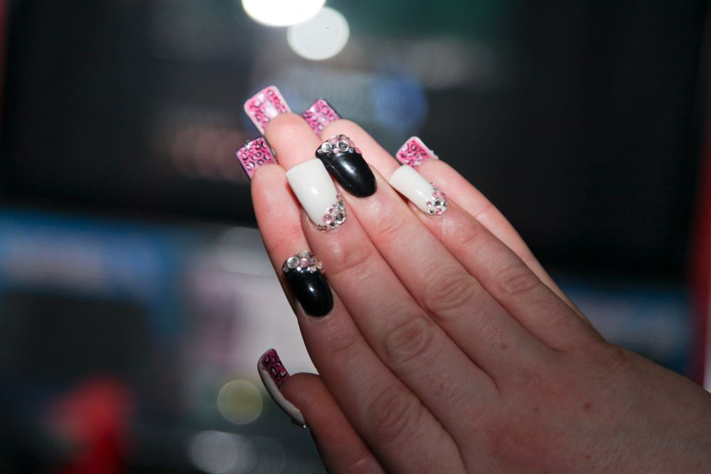 <p>Brooke Wickham created this set, adding a design to the backside of Danika Cross' nails.</p>