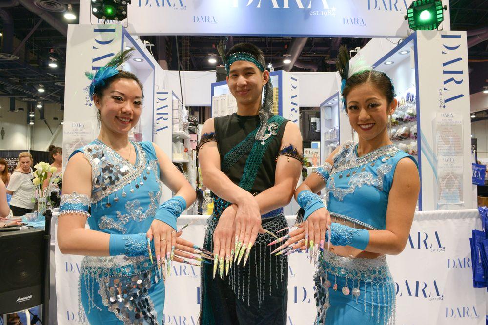<p>Gloria Tu, Jonathan Lau, and Josephine Shih danced while showcasing nails by Dara Inc. and Saga Nail Polish</p>