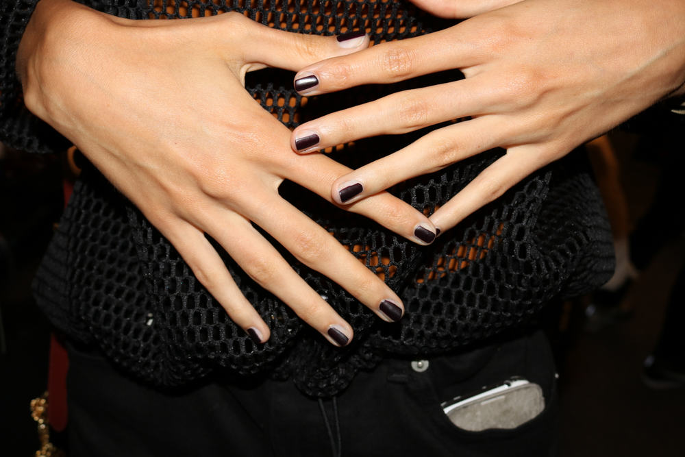 <p>Jin Soon Choi changed it up by adding white or black stripes to nails at Vera Wang.</p>
