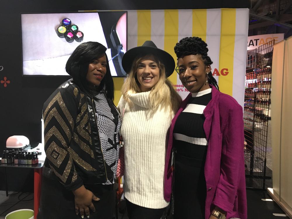<p>Tameka Jackson, Natalie Minerva, and Lavette Cephus at the Nail Labo booth</p>
