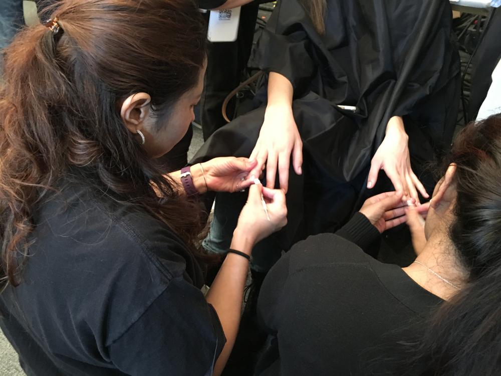 <p>Techs polishing nails at Vera Wang</p>