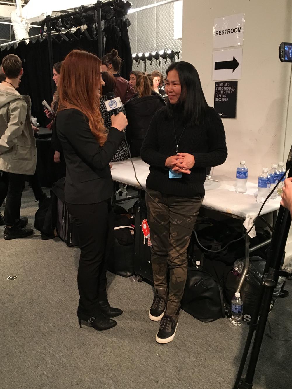 <p>Jin Soon being interviewed backstage at Vera Wang</p>