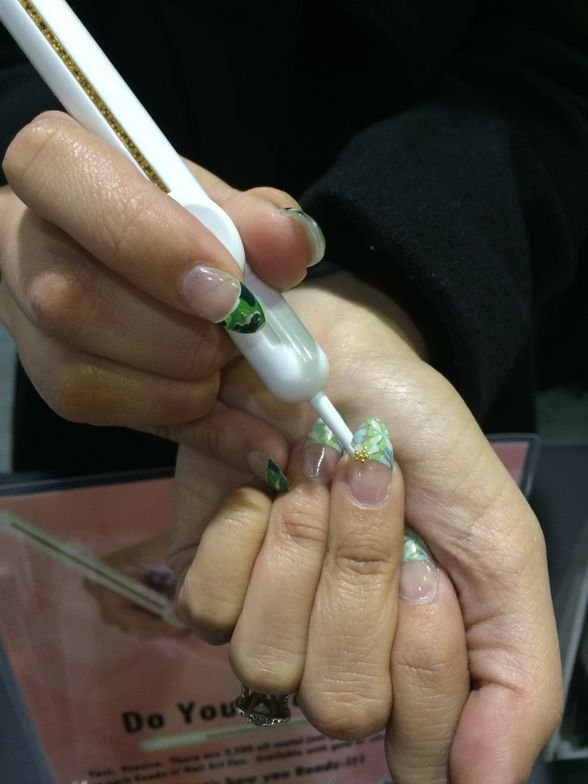 <p>Nail tech Aja Wada demonstrates Beadz-It.</p>