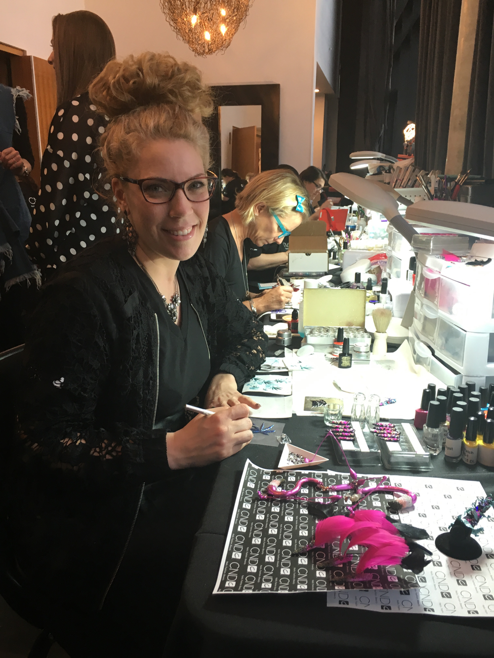 <p>Torie Bastian, artist in residence, hard at work in The Design Lab</p>