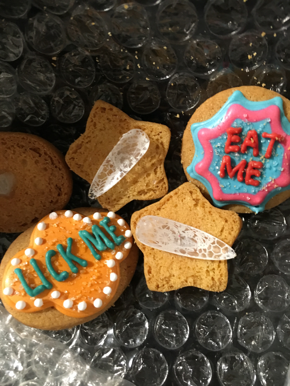 <p>Edible glue attached these mini cookies to the nail tips</p>