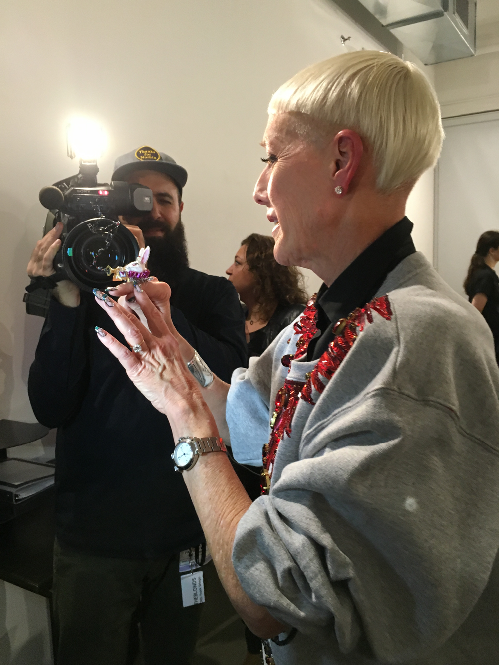 <p>Jan Arnold speaking to the press backstage before The Blonds show</p>
