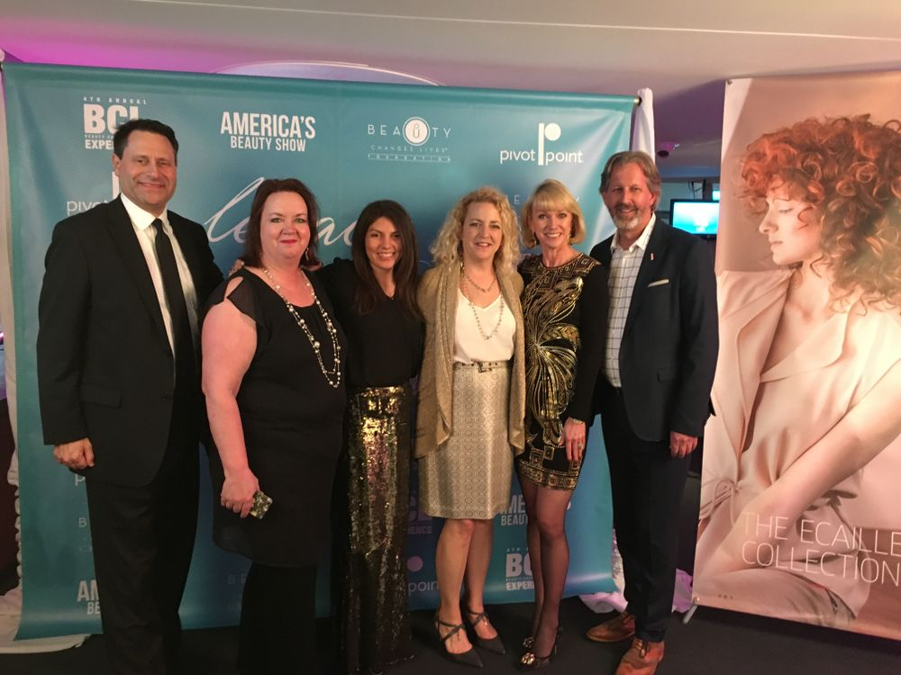 <p>Steve Reiss and Michele Musgrove (second from left) of Modern Salon with NAILS' Beth Livesay and Erika Kotite (third from right) with Lynch and Passage</p>