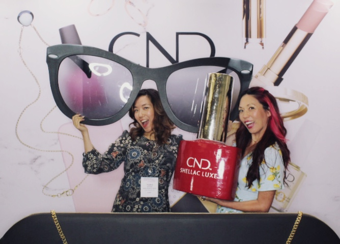 <p>CND had a prop booth that lent itself to Boomerangs and beauty-related pics.</p>