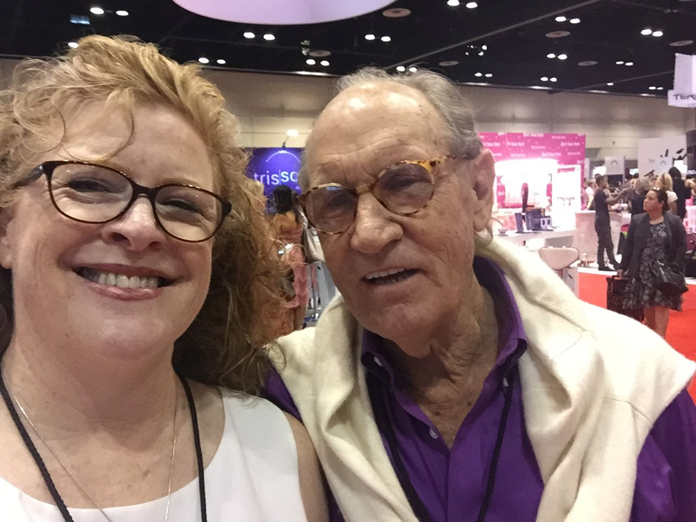 <p>Cyndy Drummey takes a selfie with NSI's Fred Slack, who was dressed in purple to match the NSI colors.&nbsp;</p>