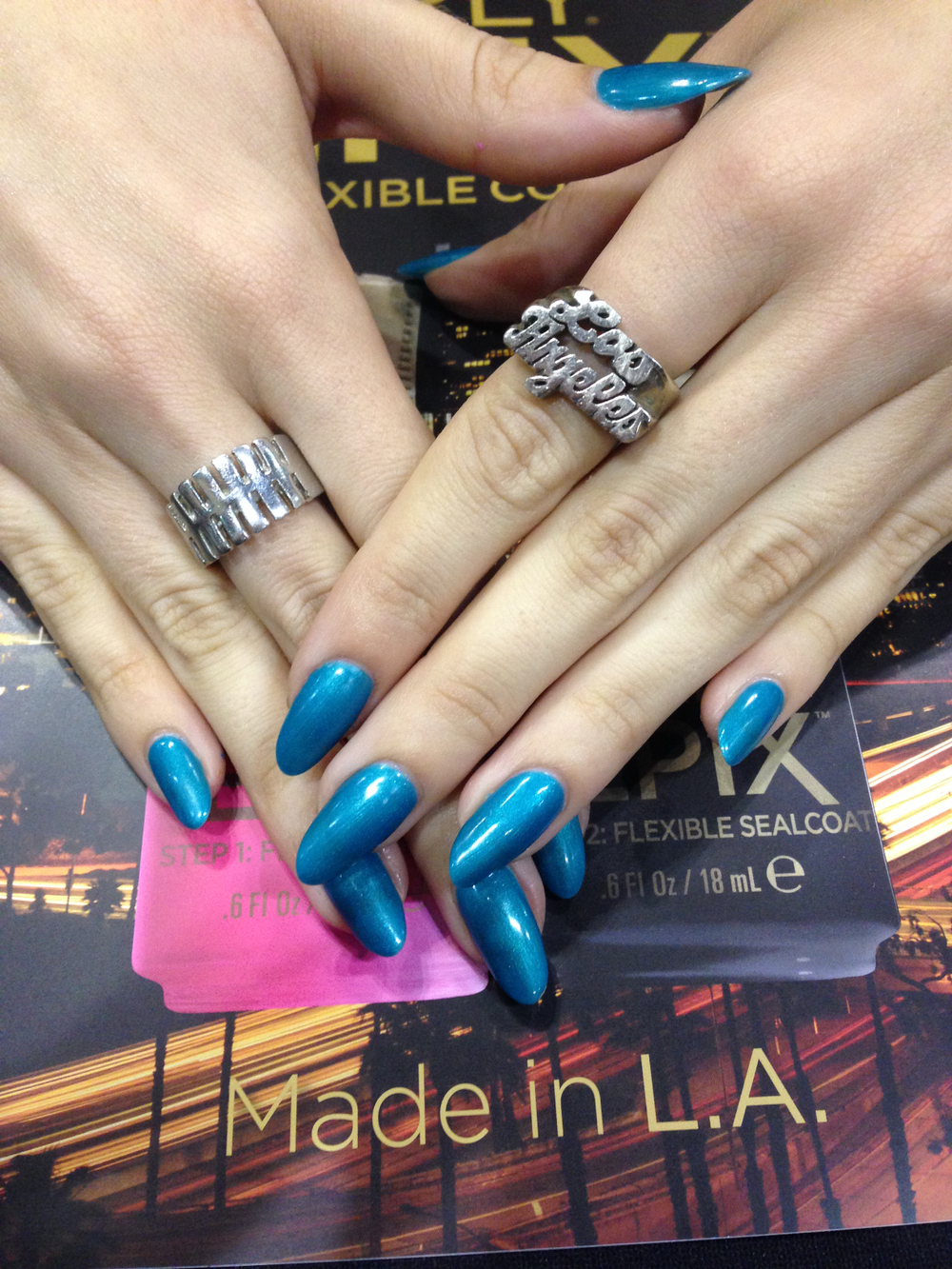 <p>Orly has been made in Los Angeles for 40 years and is celebrating the milestone at the show. Educator Denise Kelley wore Orly GelFX in It's Up to Blue with a cool LA ring for the occasion.</p>