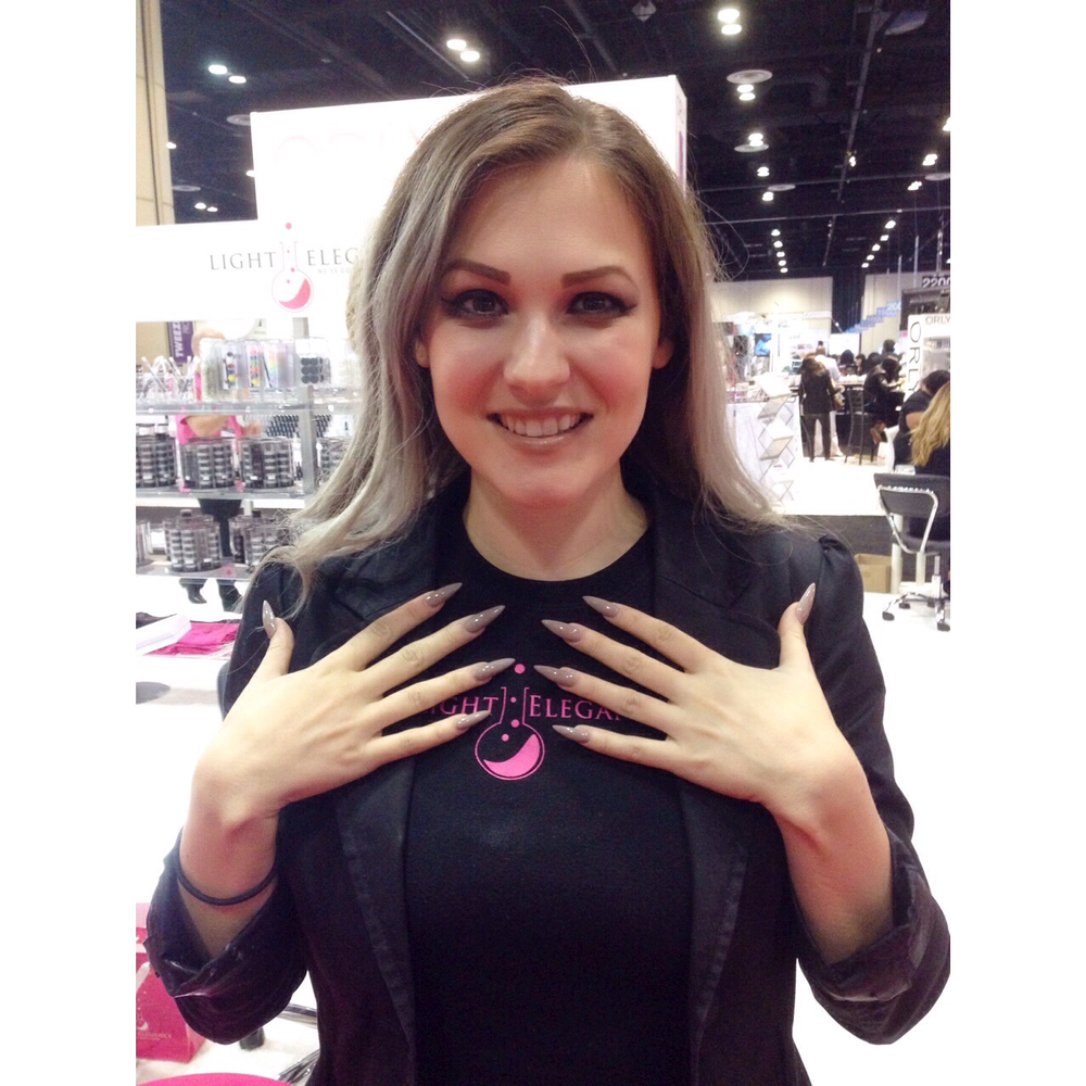 <p>NAILS NTNA Celina Ryden at hanging out at the Light Elegance booth</p>