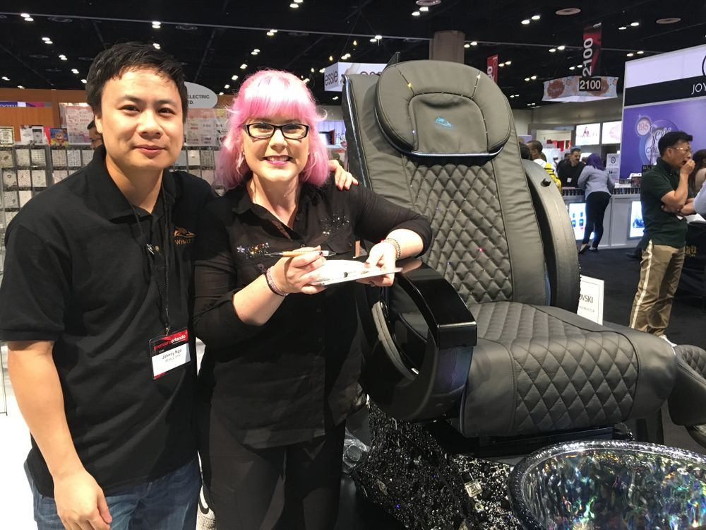 <p>Johnny Ngo and Kellie DeFries unveiled a Whale Spa pedicure chair covered in Swarovski crystals.&nbsp;</p>