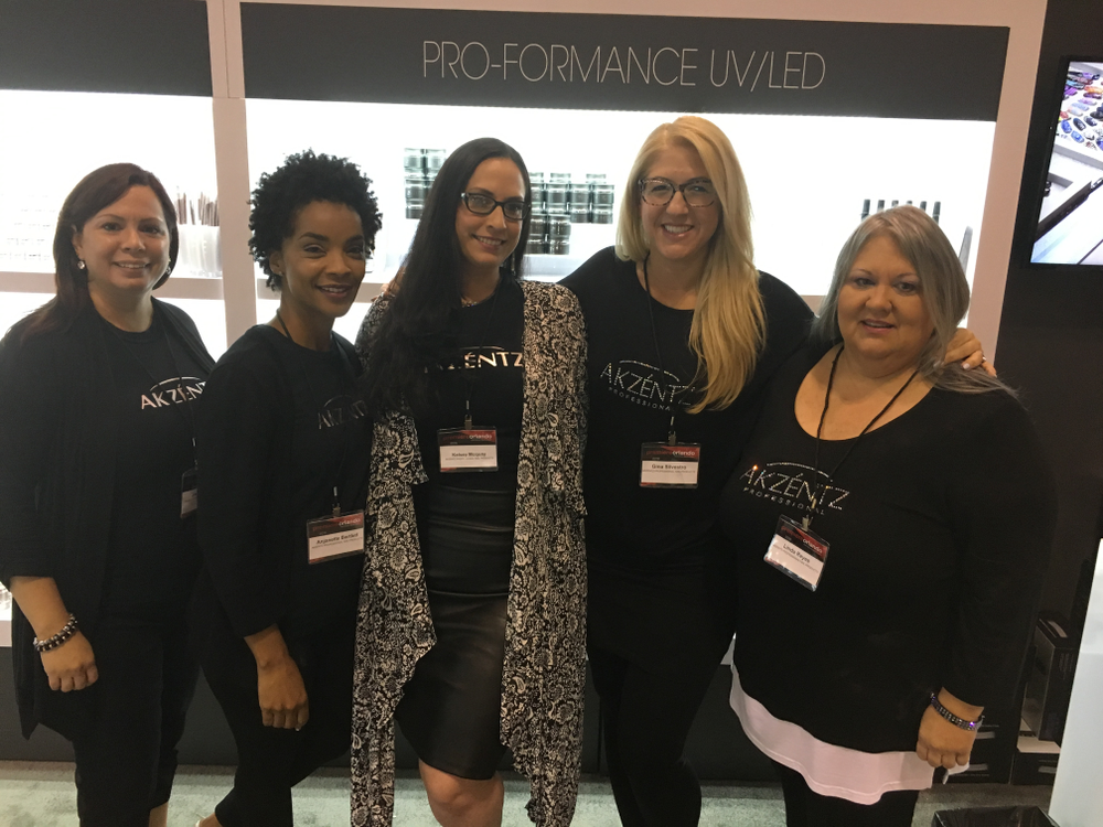 <p>The Akzentz team presented the new Hybrid Lamp Pro that cures in UV and LED. From left: Jackie Putham, Anjanette Bartlett, Kelsey Mcquay, Gina Silvestro, and Linda Reyes.&nbsp;</p>