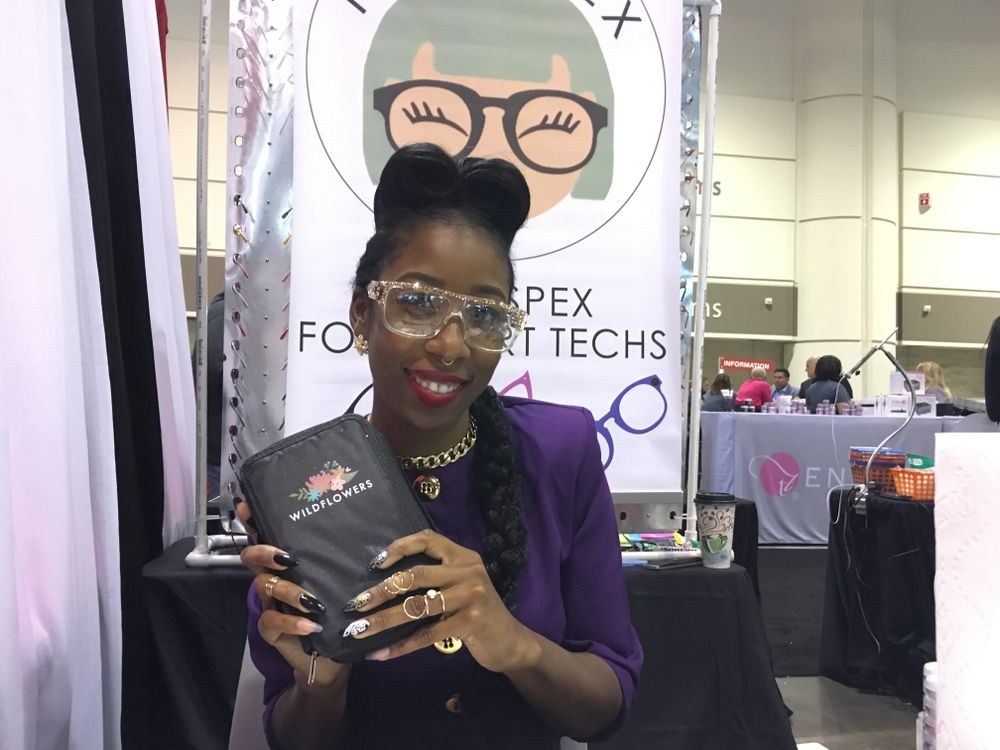 <p>NTNA champion Lavette Cephus demonstrated how to use Wildflowers Nails nail art products including NailSpex, stylish, protective eyewear.&nbsp;</p>