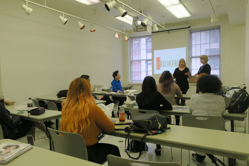 <p>Class is in session with editor Helen Oppenheim discussing international publication</p>