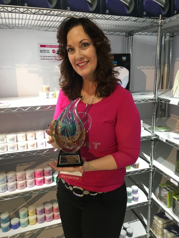 <p>LeChat gave educator Yvette Holt a trophy for 17 years of service!</p>