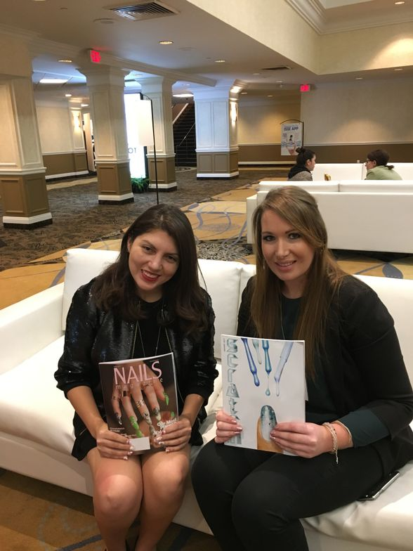 <p>Two nail editors meet: NAILS' Beth Livesay (left) and Scratch's Helena Biggs (right). Both are holding their February issues.</p>