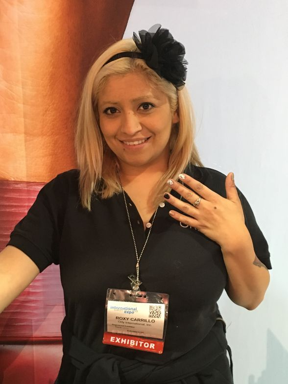 <p>Orly's Roxy Carrillo took a breather from explaining Breathable.</p>