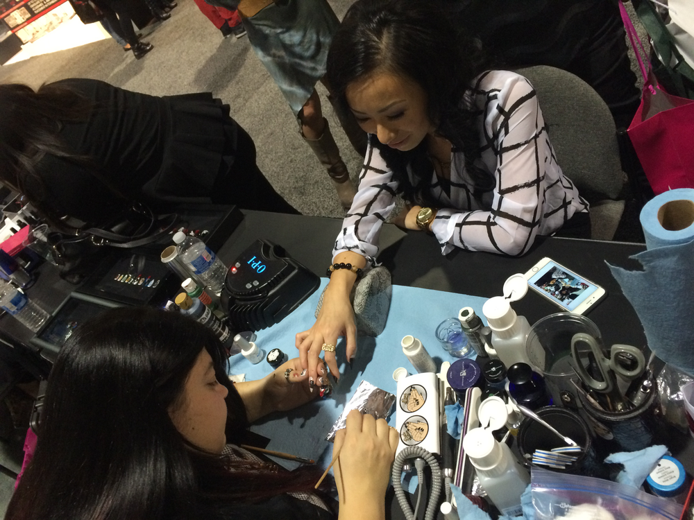 <p>Last year's NTNA winner Ryoko Garcia (right) was excited to get a nail art demo from Top 3 contestant Lexi Martone.</p>