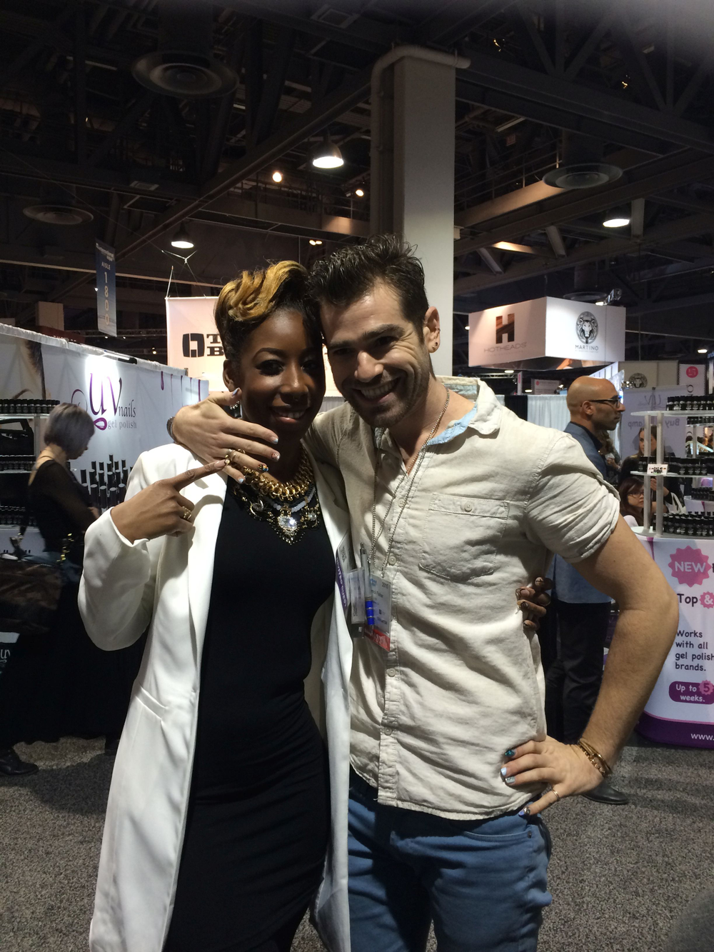 <p>NTNA winner Lavette Cephus and Merricures blogger Merrick Fisher spent some time at the NAILS booth.</p>