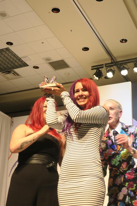 <p>Ashton Harlan holds her Swarovski crystal trophy.</p>