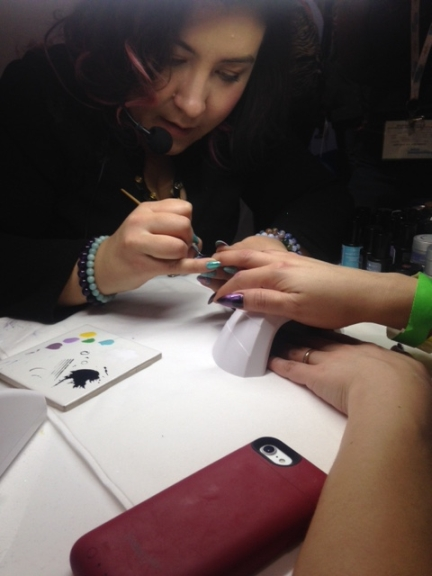 <p>Young Nails' Sabella Snyder demoing line work.</p>