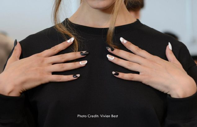 <p>Since the theme of the show was unity and connection, a negative space look dominated the runway. Miggins used INM Out the Door Lacquers, a striper brush, and matte top coat to get the look.&nbsp;</p>