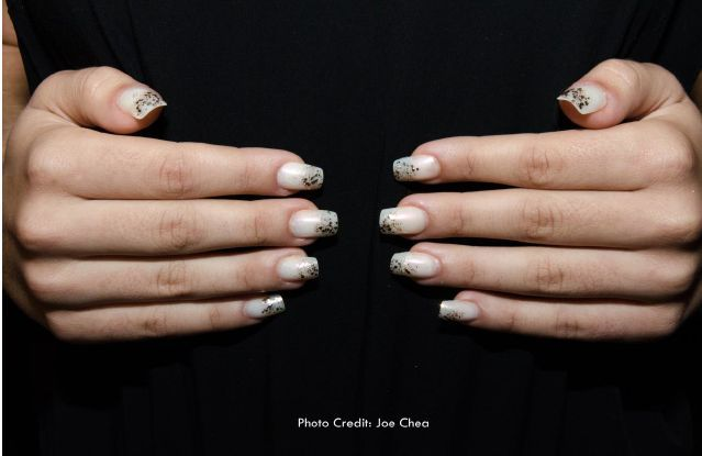 <p>Rose Velez-Miggins used INM's French Pink and Pink Chiffon along with gold glitter to make these sparkly nails at Cesar Galindo.&nbsp;</p>