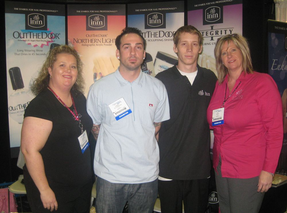 """<p>Jennifer McCormick, Garrett Kellenberger, Chris Hofer, and Juli Miller help introduce <a href=""""http://www.inmnails.com"""">INM</a>&rsquo;s new Nature&rsquo;s Cure pedicure line to show attendees.</p>"""