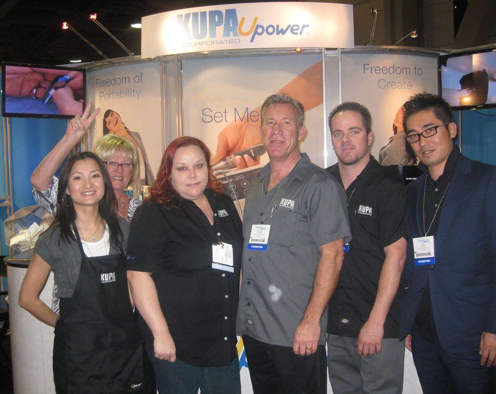 "<p>Ann Chang, Vicki Peters, Sara Smith, Richard Hurter, Robert Arthur, and Hiro Matsugsi assisted customers at the <a href=""http://www.kupainc.com"">Kupa</a> booth.</p>"