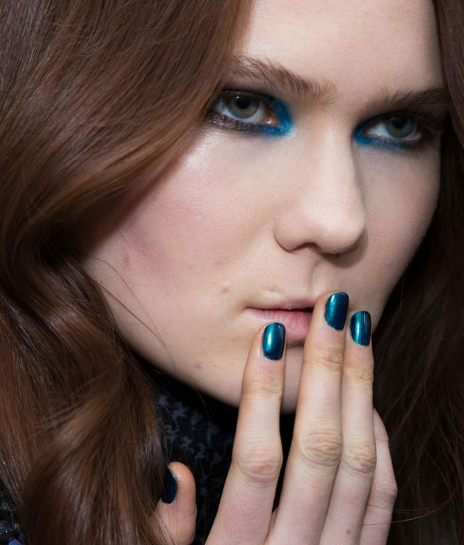 <p>Choi thought up a rich, blue metallic nail for the Karen Walker show.</p>