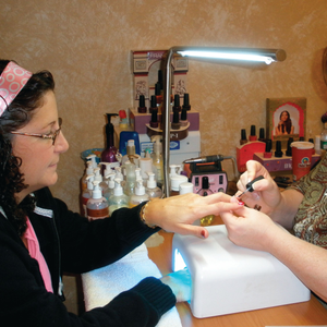 Christine McGrath gets acrylic clients interested in gels by putting a gel sealer over their nails.