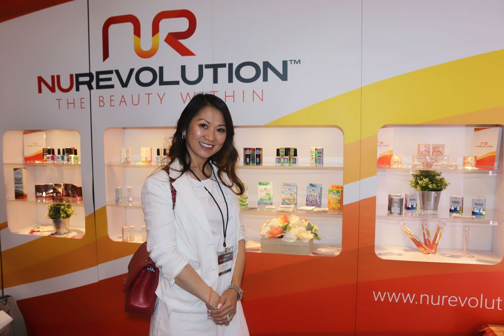 <p>Famous nail tech Jenny Bui poses at the NuRevolution booth.</p>