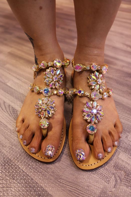 <p>Jenny Bui, the self-proclaimed Queen of Bling, had blinged out toenails and sandals.</p>