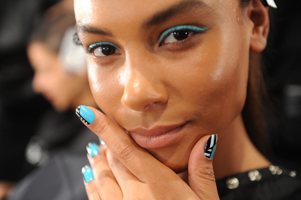 <p>Gina Edwards for KISS created this Capri Cool nail art look at Christian Siriano.</p>
