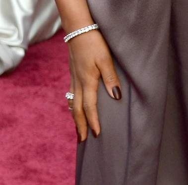<p>A close up of Kerry Washington's Oscar nails. Get the look by applying two cats of butter LONDON nail lacquer in La Moss as a base. Apply a layer of Saucy Jack to redden the nails. FInish with a matte top coat. Image via @butterLONDON.</p>