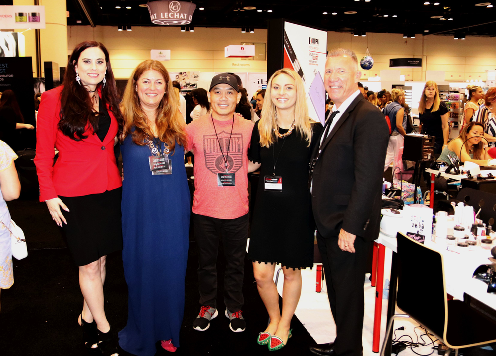<p>Alternating with Kupa and NAILS Magaze team members, everyone stopped for a quick photo opp on the show floor!</p>