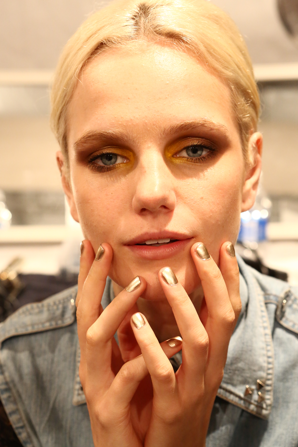 <p><strong>Essie</strong>&rsquo;s Good as Gold played up the feminine feel of flowers, lace, and chain at Lela Rose&rsquo;s collection.</p>