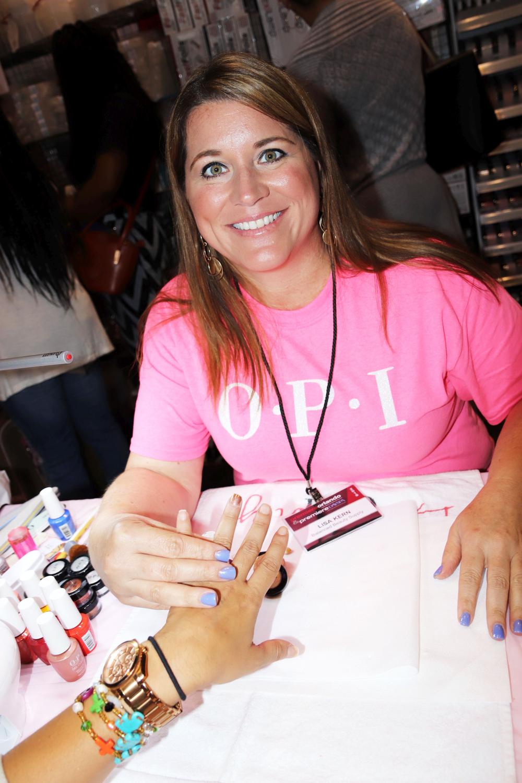 <p>OPI Educator Lisa Kern shows off a chrome nail at the Balanced Beauty Supply booth.</p>