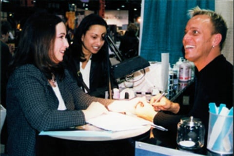 <p>Tom Holcomb working the EZ Flow booth at a tradeshow in the late 1990s.</p>