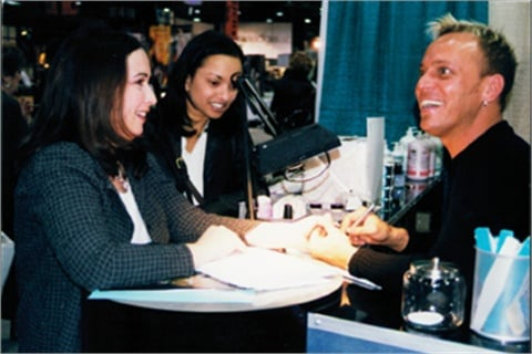 <p>Tom doing nails at a tradeshow for EZ Flow, who he worked for at one time.</p>