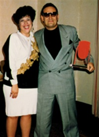 Helen Vanegas shown here in 1993 at NAILS Magazine's 10th Anniversary party with Tony Cuccio of Star Nail Products.