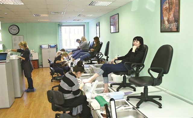 <p>Students at OleHouse learn how to do pedicures using CND products.</p>