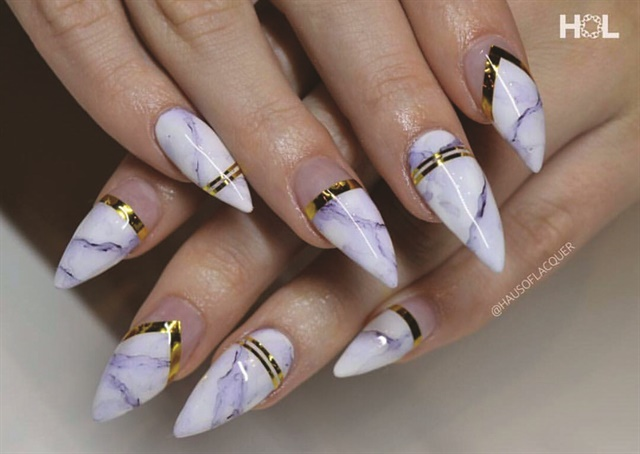 Stephanie Urmeneta, a nail artist and technician at Haus of Lacquer, created these marbled and gold-accented nails.